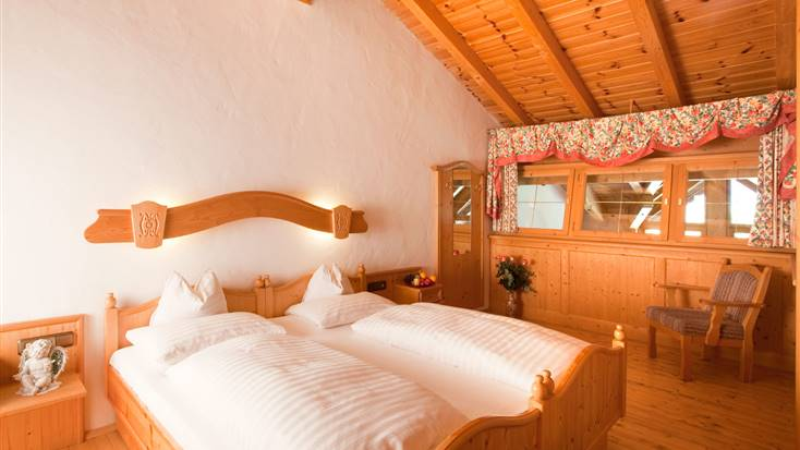 Great room view from the double bed with sleeping gallery from the Family Suite Kitzbühel