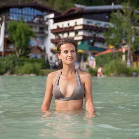 Woman standing in the lake in a bikini