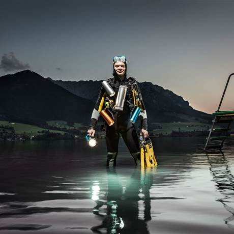 Man in diving outfit ready for diving in the lake