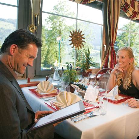 Couple sits in the restaurant and reads the menu