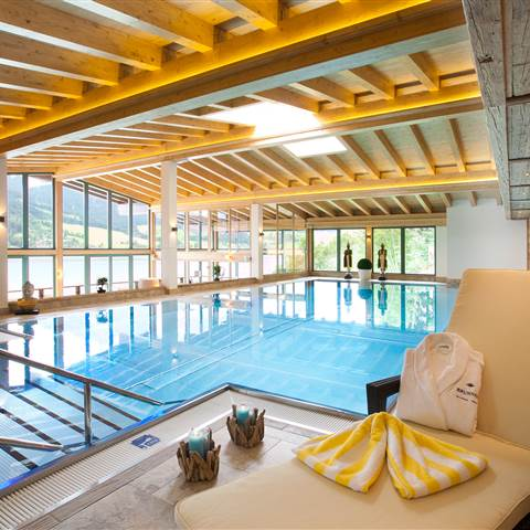 Indoor swimming pool with panoramic view of a lake