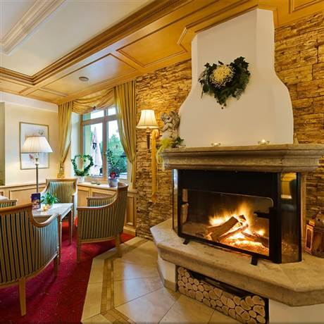 Traditional hotel lobby with fireplace